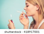 pretty girl smoking cigarette... | Shutterstock . vector #418917001