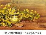 Rapeseed Oil With Rape Flowers.