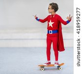 superman kid playing skateboard ... | Shutterstock . vector #418959277