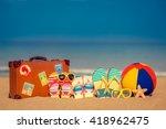 vintage suitcase and flip flops ... | Shutterstock . vector #418962475