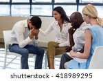 colleagues comforting a unhappy ... | Shutterstock . vector #418989295