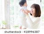 portrait of young asian family... | Shutterstock . vector #418996387