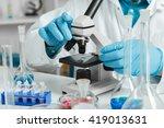 men in a laboratory microscope... | Shutterstock . vector #419013631