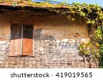 old wooden house with plant...