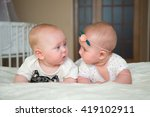 Two Beautiful Baby Lying On Th...