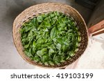 tea tips in wood basket. | Shutterstock . vector #419103199