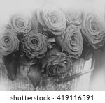Red Roses In Metal Bucket With...