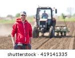 Young Farmer On Farmland With...