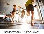 running on treadmills | Shutterstock . vector #419239624