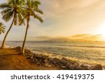 Palm Trees At Sunset On A...
