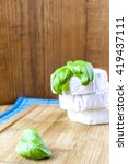 camembert and basil on wooden... | Shutterstock . vector #419437111