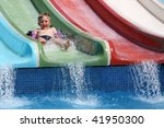 the boy slides a waterslide  in ... | Shutterstock . vector #41950300
