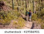 Two Desert Hikers In The...
