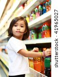 young asian girl shopping at the grocery - stock photo