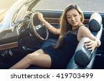smiling attractive girl sitting ... | Shutterstock . vector #419703499