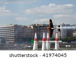 BUDAPEST - AUGUST 18: Nicolas Ivanoff performs at Red Bull air race on August 18, 2008 in Budapest, Hungary - stock photo