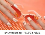 sunny orange manicure with dots ... | Shutterstock . vector #419757031
