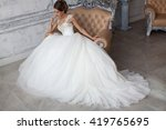 the girl in a wedding dress....   Shutterstock . vector #419765695