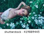 Girl Lying In A Clearing Among...
