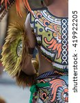 Small photo of colorful indian native costume details in San Migueld de Allende, Mexico