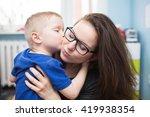 A Photo Of Little Boy Hugging...