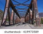Rusty Bridge In Desert Town