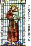 Small photo of GALLWAY, IRELAND - CIRCA FEBRUARY 2016. St Anthony of Padua, holding the baby Jesus. Church stained glass window in a parish church.