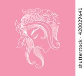 woman with flowers in hair.... | Shutterstock .eps vector #420029641