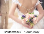 The Bride With A Bouquet Of...