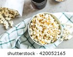bowl of salty popcorn and soda | Shutterstock . vector #420052165