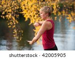 A Young Woman Doing Tai Chi By...