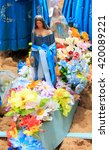 Small photo of Statues of Yemanja goddess of the sea in a offering boat taking in a procession in Brazil