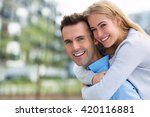 young couple smiling outdoors  | Shutterstock . vector #420116881