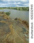 Small photo of The Illinois River is viewed from atop a sandstone rock formation in Buffalo Rock State Park, LaSalle County, Illinois