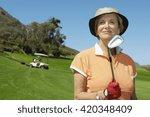 Senior Woman Playing Golf In...