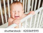 a year old child is crying in... | Shutterstock . vector #420369595
