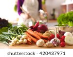young woman cooking in the... | Shutterstock . vector #420437971