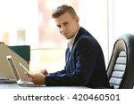 man using laptop and smart... | Shutterstock . vector #420460501