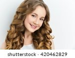 girl with long curly hair | Shutterstock . vector #420462829