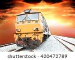vintage train at sunset | Shutterstock . vector #420472789