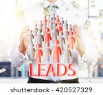 Small photo of Lead generation with businessman and staff icons. potential client consept. Business man hold leads.