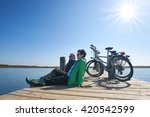 senior couple with their bikes  ... | Shutterstock . vector #420542599