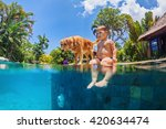 Stock photo funny underwater photo of little baby and dog swimming in blue outdoor pool children water sports 420634474