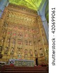 Small photo of JUL 11 2015: Impressive altarpiece made of gold from the Cathedral of Saint Mary of the See (Seville Cathedral) in Seville, Andalusia, Spain