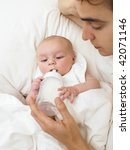 father feeding baby while in... | Shutterstock . vector #42071146