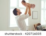proud father holding his... | Shutterstock . vector #420716035
