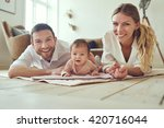 proud mother and father with... | Shutterstock . vector #420716044