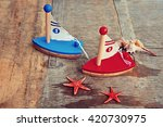 Two Toy Sailboats And Sea...