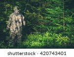 Illegal Hunting Poacher in the Forest. Poacher with Rifle. - stock photo
