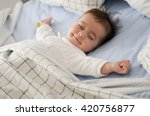 smiling baby girl lying on a... | Shutterstock . vector #420756877